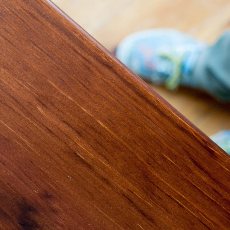 Helen table in antique cherry, closeup tabletop finish detail