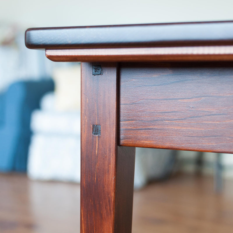 Helen table in antique cherry, closeup, leg detail