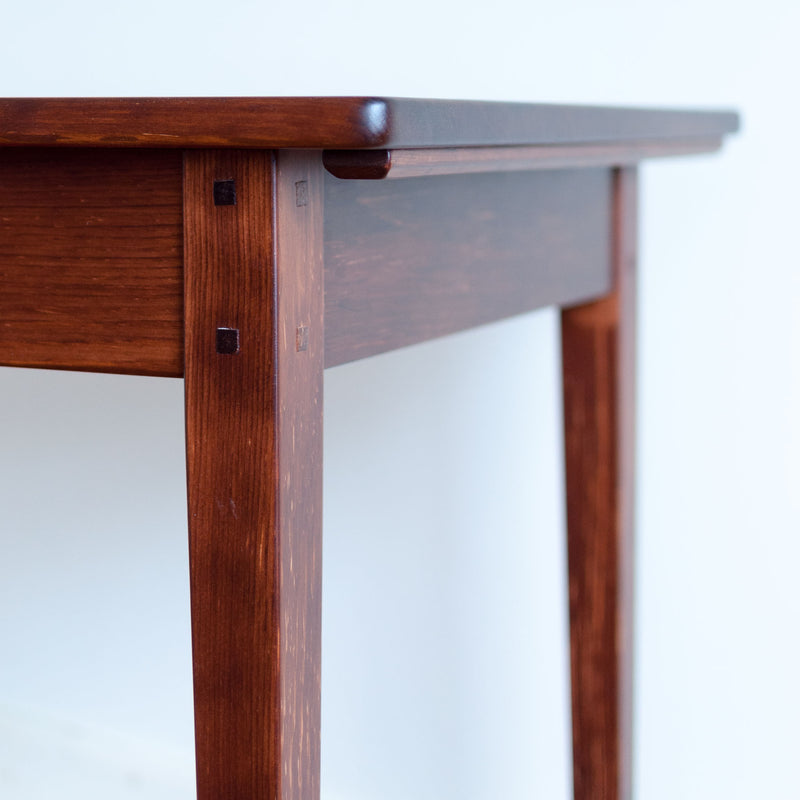 Helen table in antique cherry, closeup leg detail