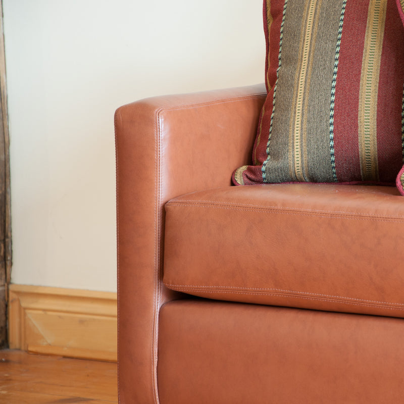 The Holden leather sofa in whisky, arm detail