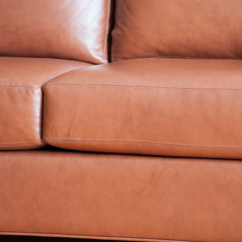 The Holden leather sofa in whisky, closeup