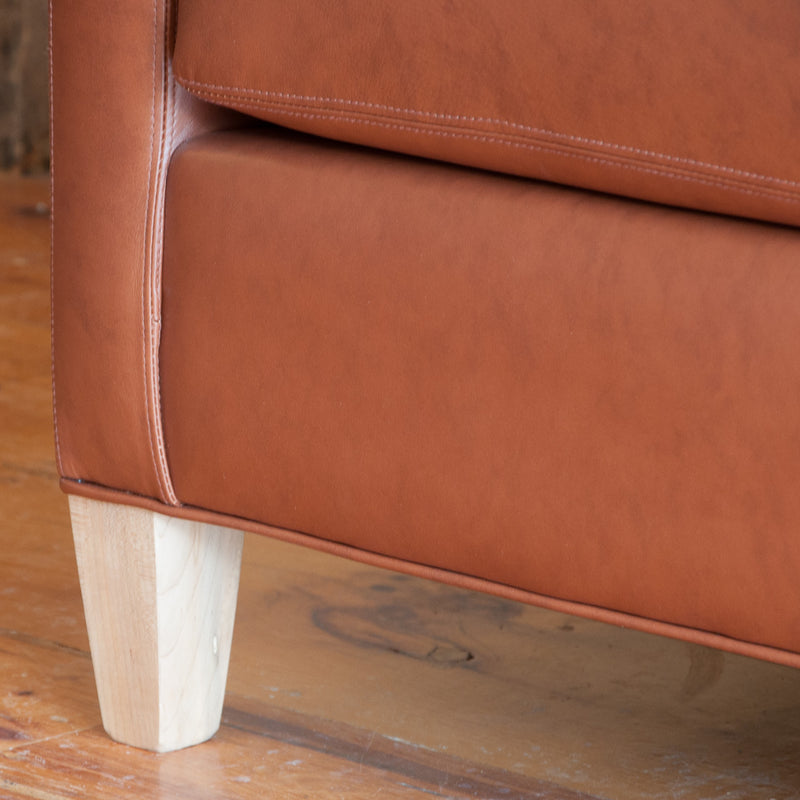 The Holden leather sofa in whisky, leg detail