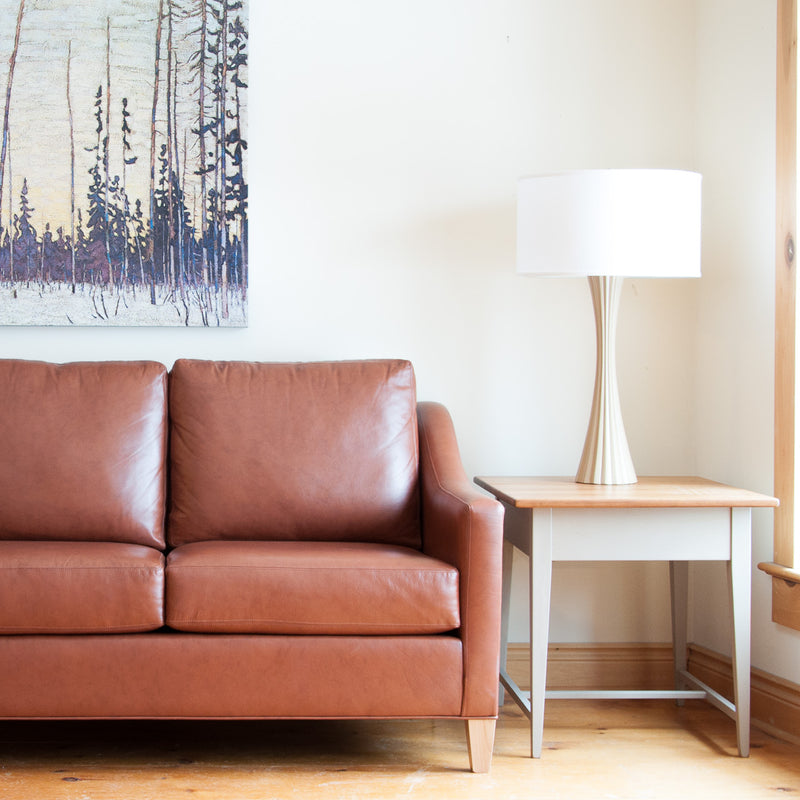 The Holden leather sofa in whisky, lifestyle shot
