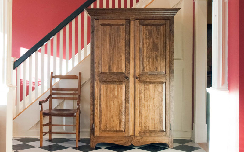 Solid wood raised panel armoire in provincial, wide angle with chair