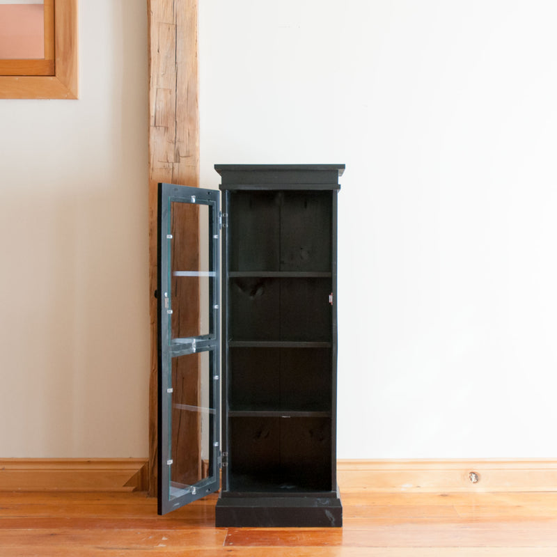 Standard display cabinet in black, straight on view, door open.