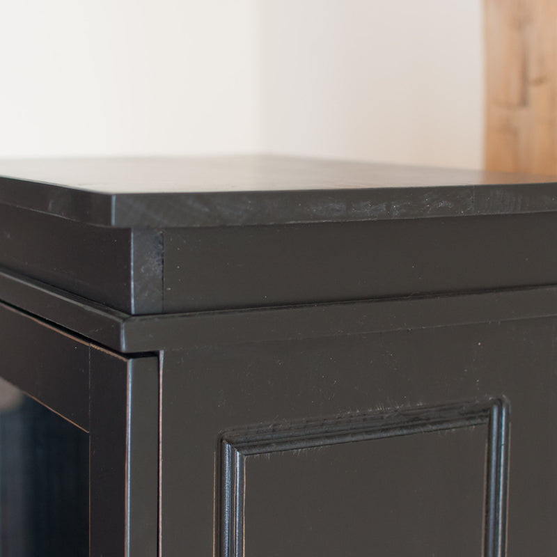 Standard display cabinet in black, close up.