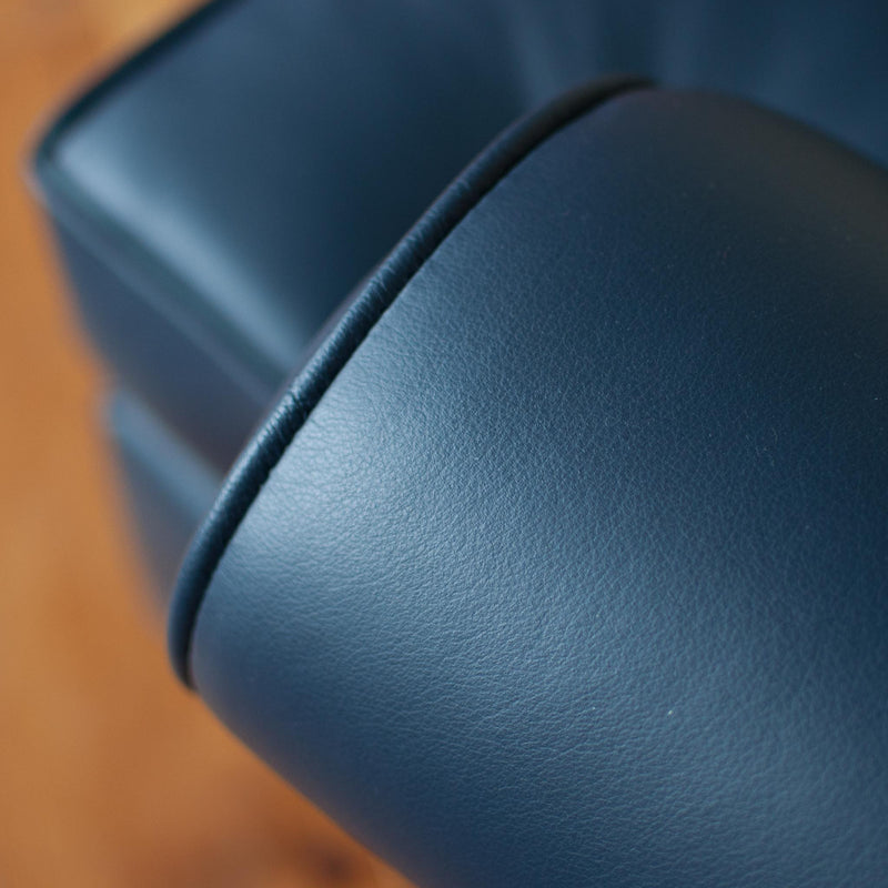 Walmer wingback chair in navy leather, close up arm detail
