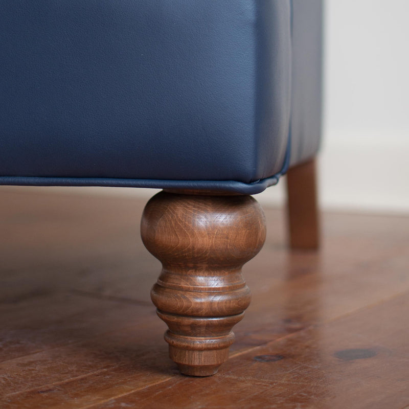 Walmer wingback chair in navy leather, close up leg detail closeup