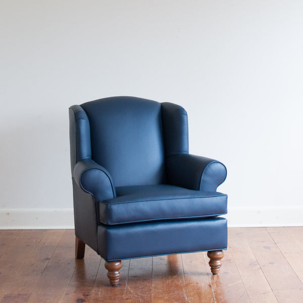 Walmer wingback chair in navy leather, angle view