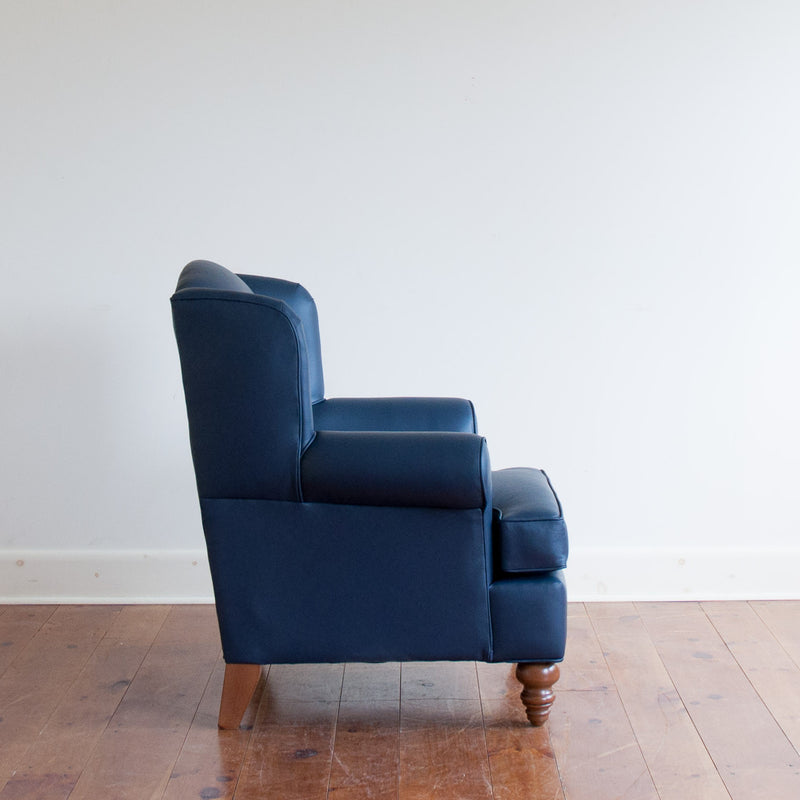 Walmer wingback chair in navy leather, profile view