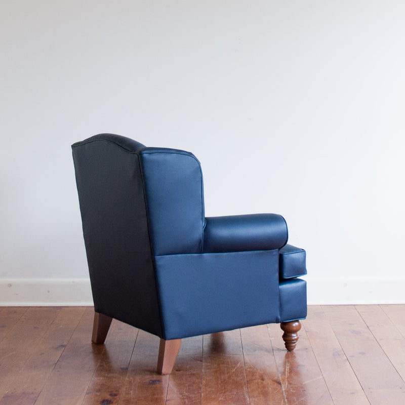 Walmer wingback chair in navy leather, rear angle view
