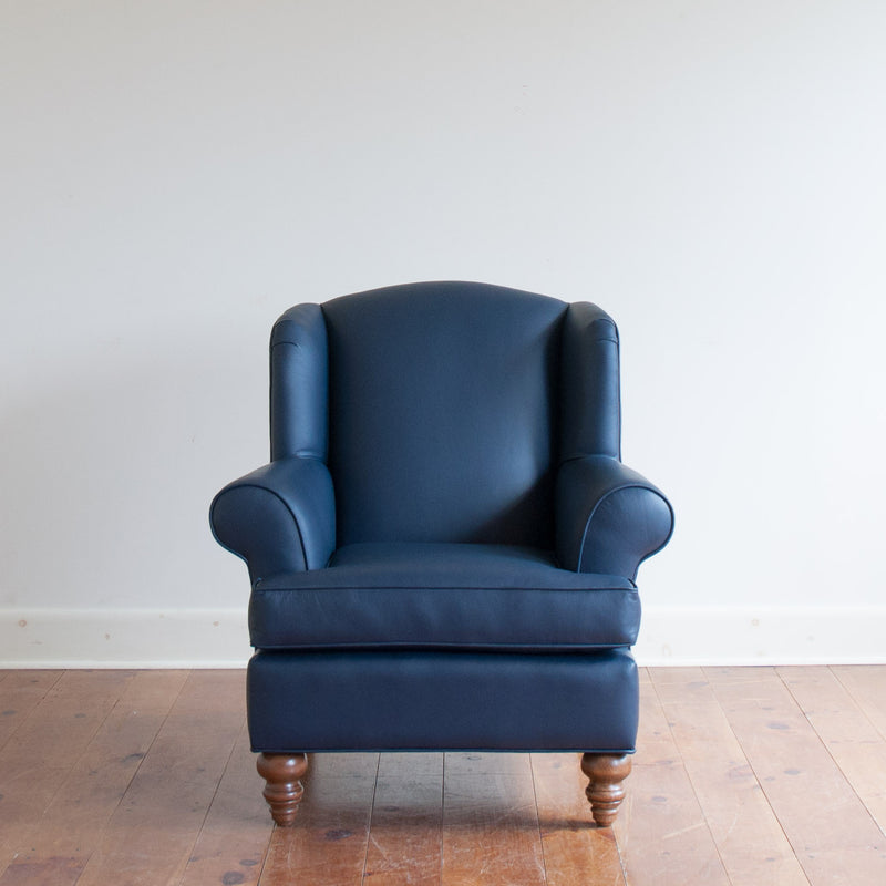 Walmer wingback chair in navy leather, straight on