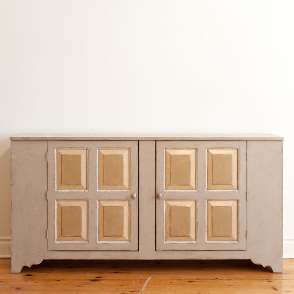 Close up, font on view of pewter sideboard with two quadruple raised panel doors.