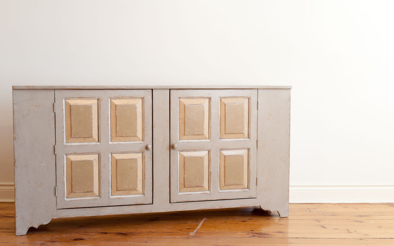 Close up, angle view of pewter sideboard with two quadruple raised panel doors.