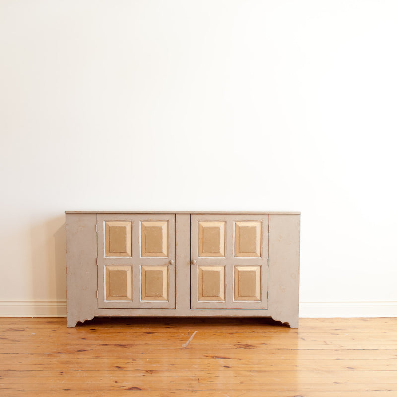 Cropped out view of pewter sideboard with two quadruple raised panel doors.