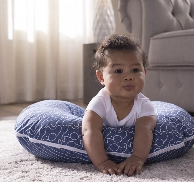 Baby doing tummy time on a Boppy Pillow