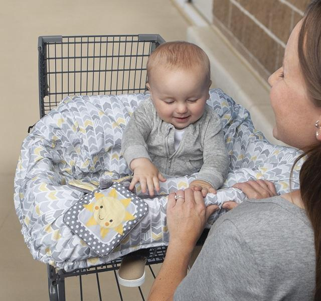 Baby sitting in the Boppy® Shopping Cart and High Chair Cover