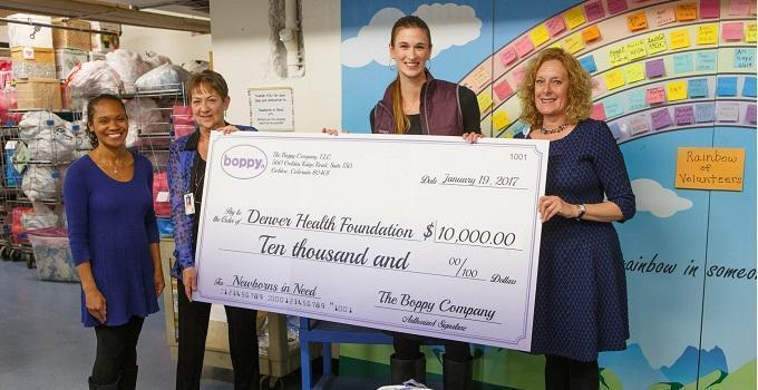 The Boppy Company presenting a $10,000 check to Denver Health Foundation