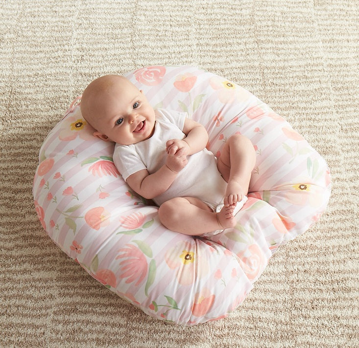 Newborn baby in a newborn lounger