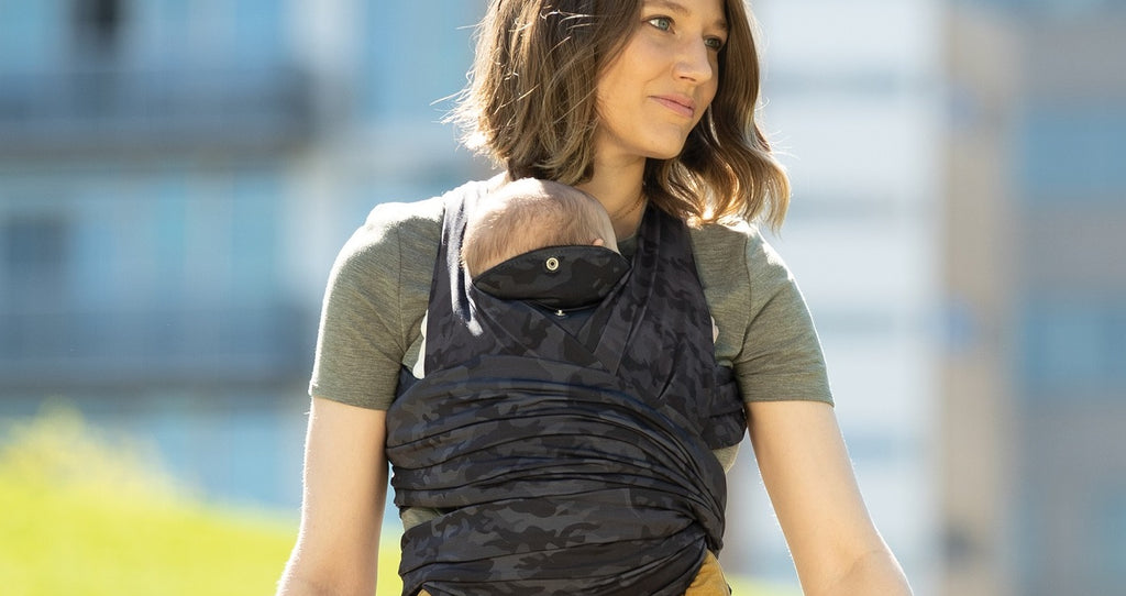 Mom wearing Boppy ComfyFit Camo Carrier
