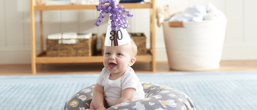 Baby wearing a birthday hat