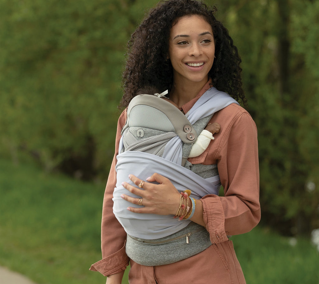 Mom wearing the pearl Boppy ComfyChic Baby Carrier