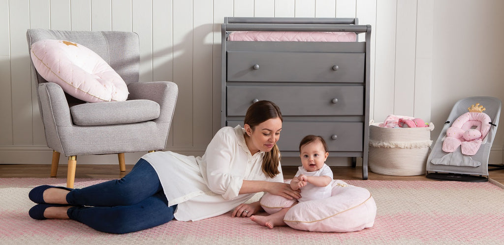 Mother and baby in a Pink Princess themed nursery.