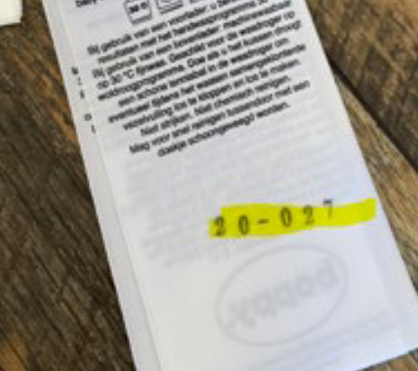 Photo of the date code stamped on the back of the second label.