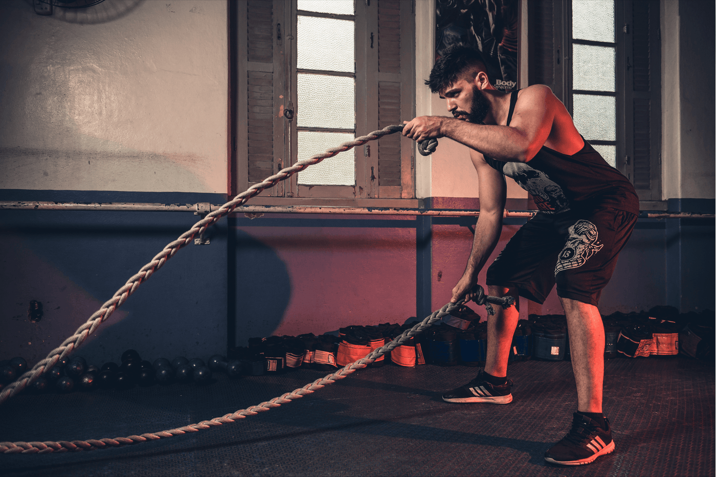 young man with battle rope doing exercise