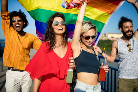 a group of people waving a gay pride flag