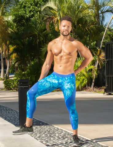 male model wearing blue leggings for men with printed designs
