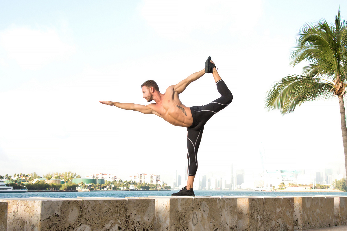 Man performing yoga in Matador Meggings