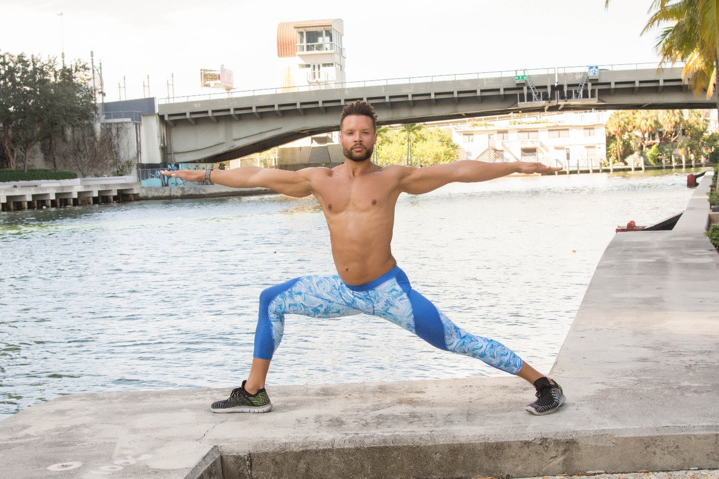 man Practicing Warrior Yoga Pose