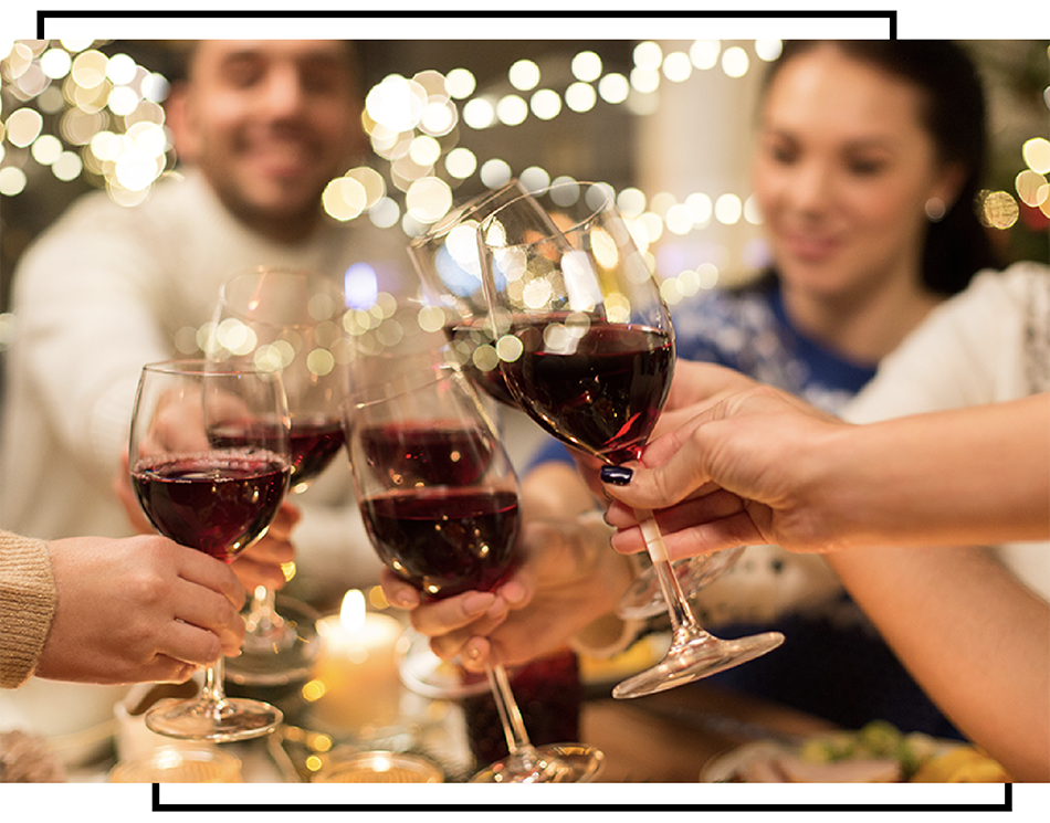 family of friends toasting with wine glasses