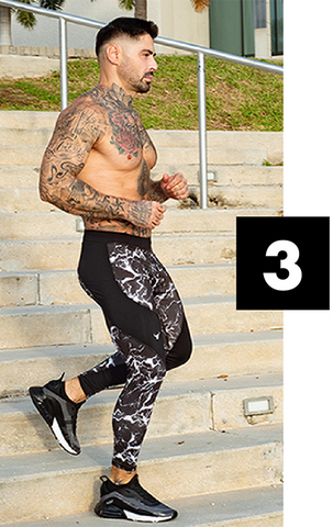 male model with tatoos wearing black men's compression leggings