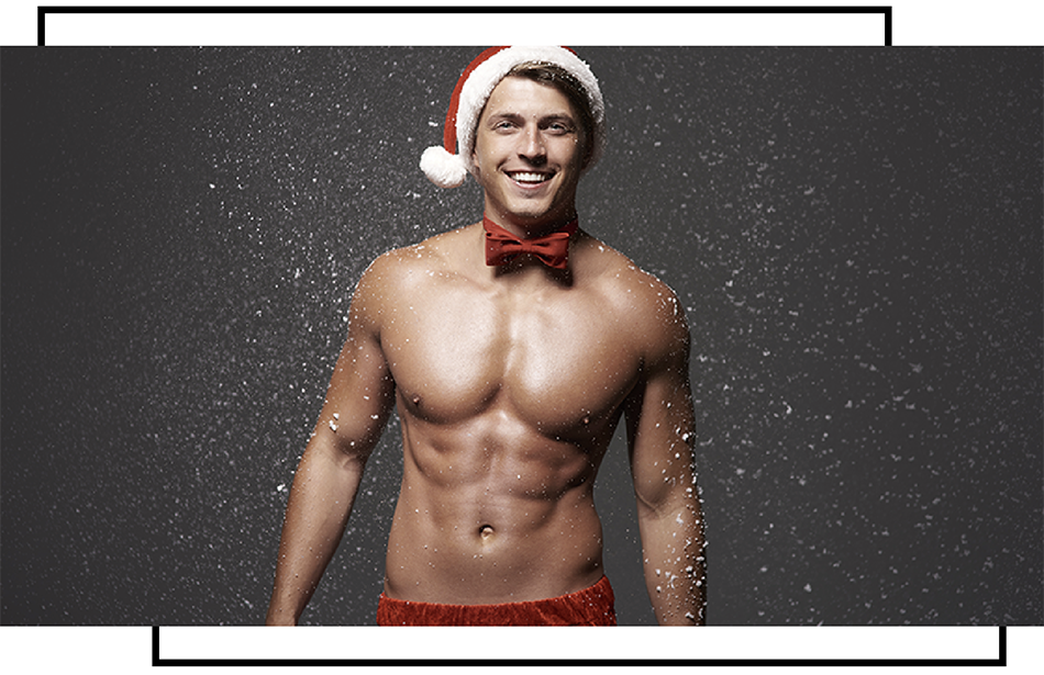 shirtless male model posing in the snow