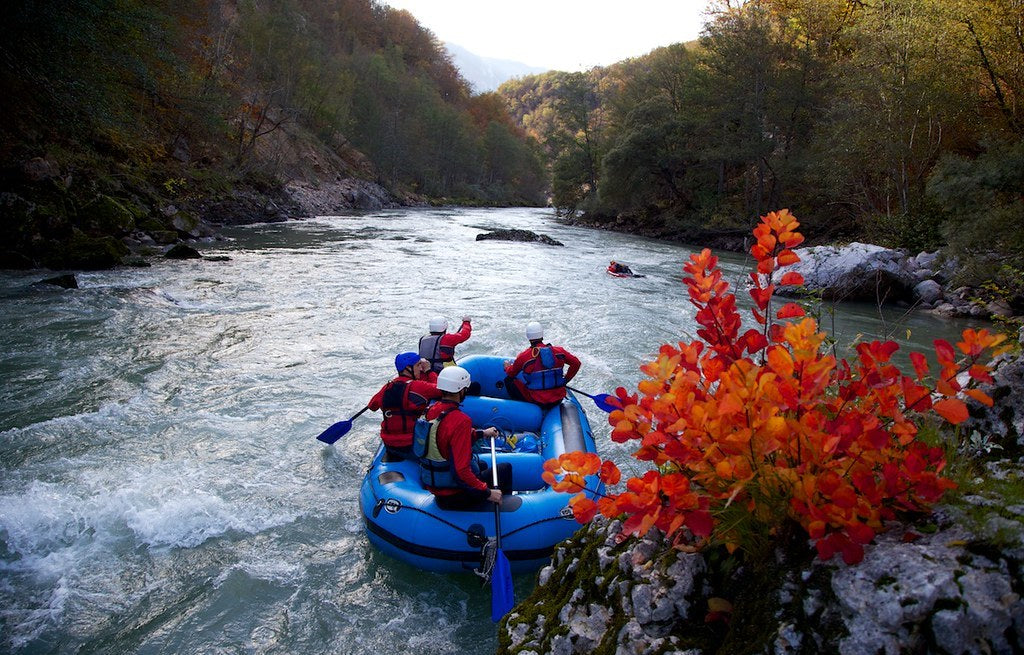 A group of men rafting on a river
