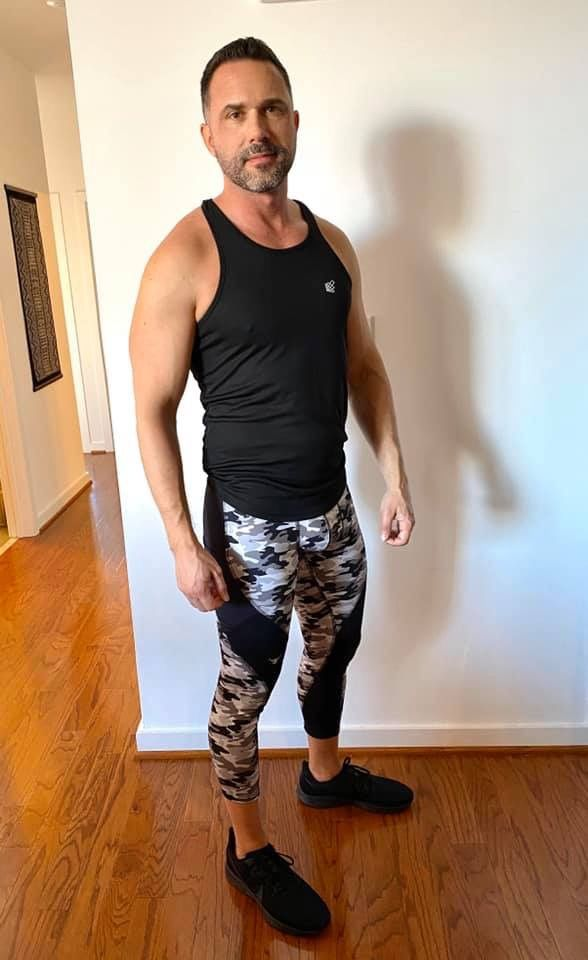 man posing in meggings