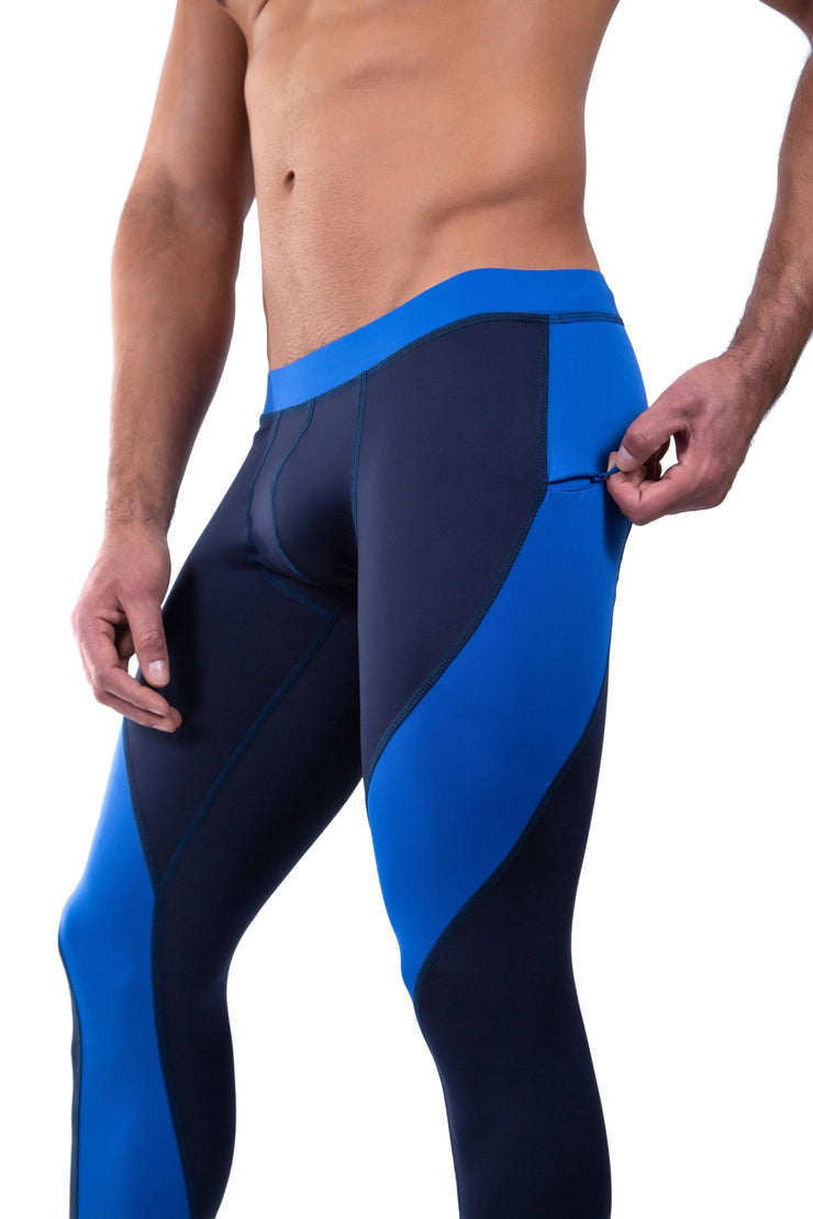man zipping pocket of navy blue meggings