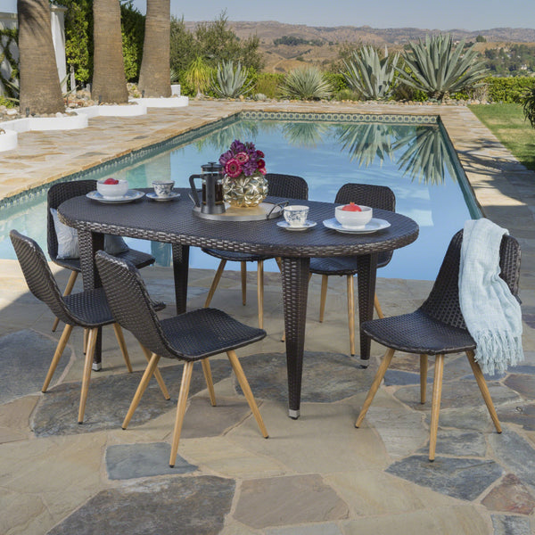 Libby Outdoor 7 Piece Wicker Oval Dining Set