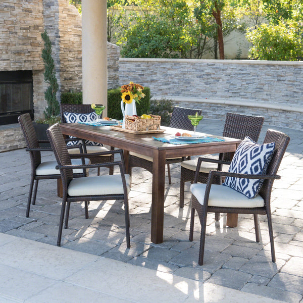 Gaston Outdoor 7 Piece Dining Set With Finished Wood Table And Wicker Dining Chairs With Water Resistant Cushions
