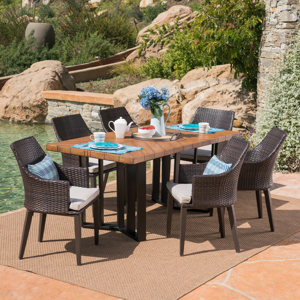 Elijah Outdoor 7 Piece Wicker Dining Set With Textured Finish Concrete Dining Table And Water Resistant Cushions