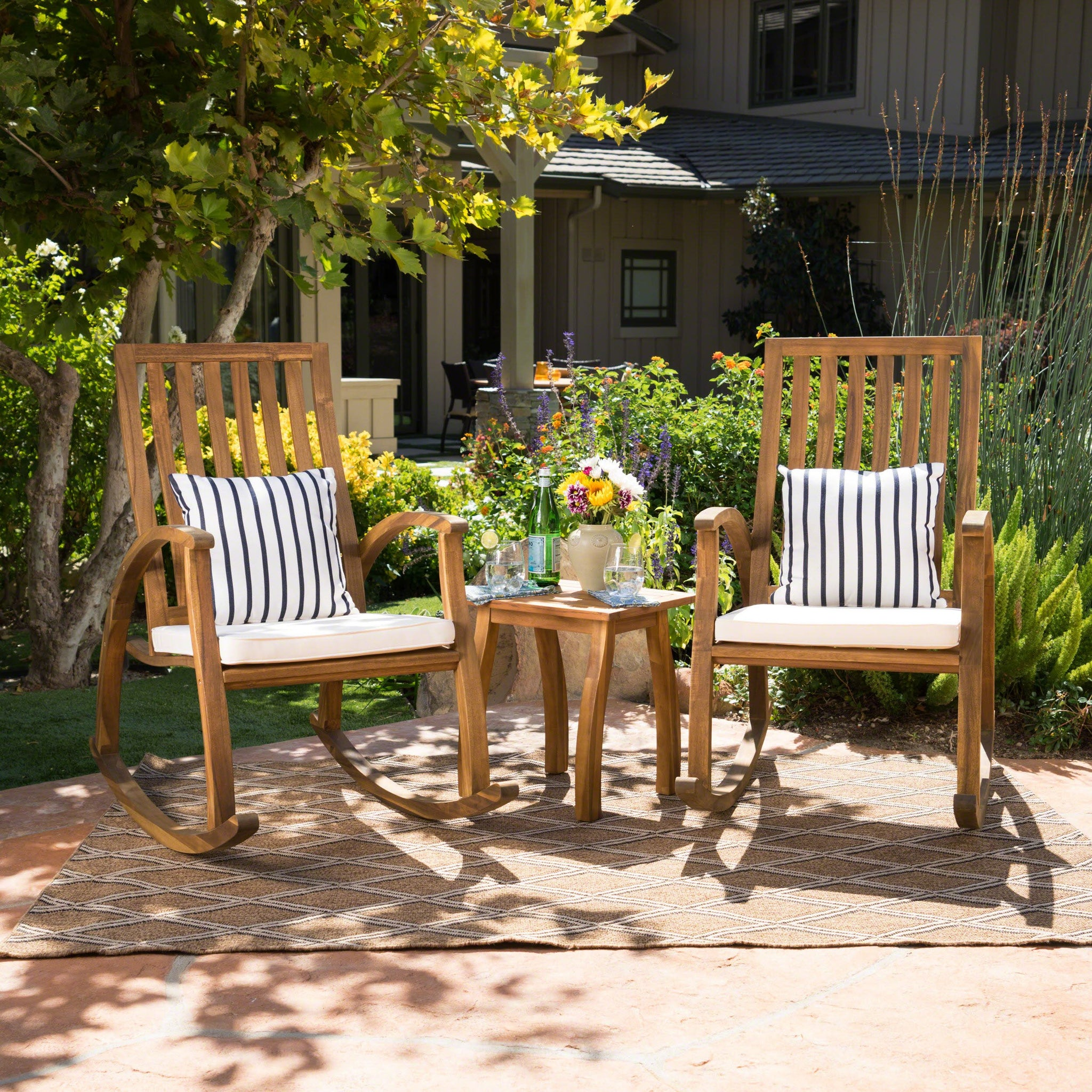 Cavalier Outdoor Natural Stained Acacia Wood Rocking Chair Chat Set With Teak Finished Table And Water Resistant Cushions