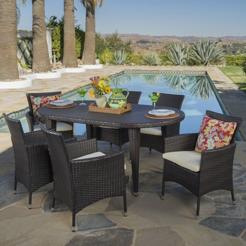 Vida Outdoor 7 Piece Wicker Oval Dining Set With Water Resistant Cushions