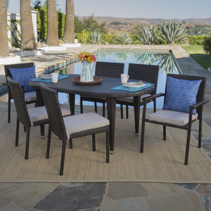 Lochner Outdoor 7 Piece Wicker Oval Dining Set With Armed And Armless Stacking Chairs And Textured Water Resistant Cushions