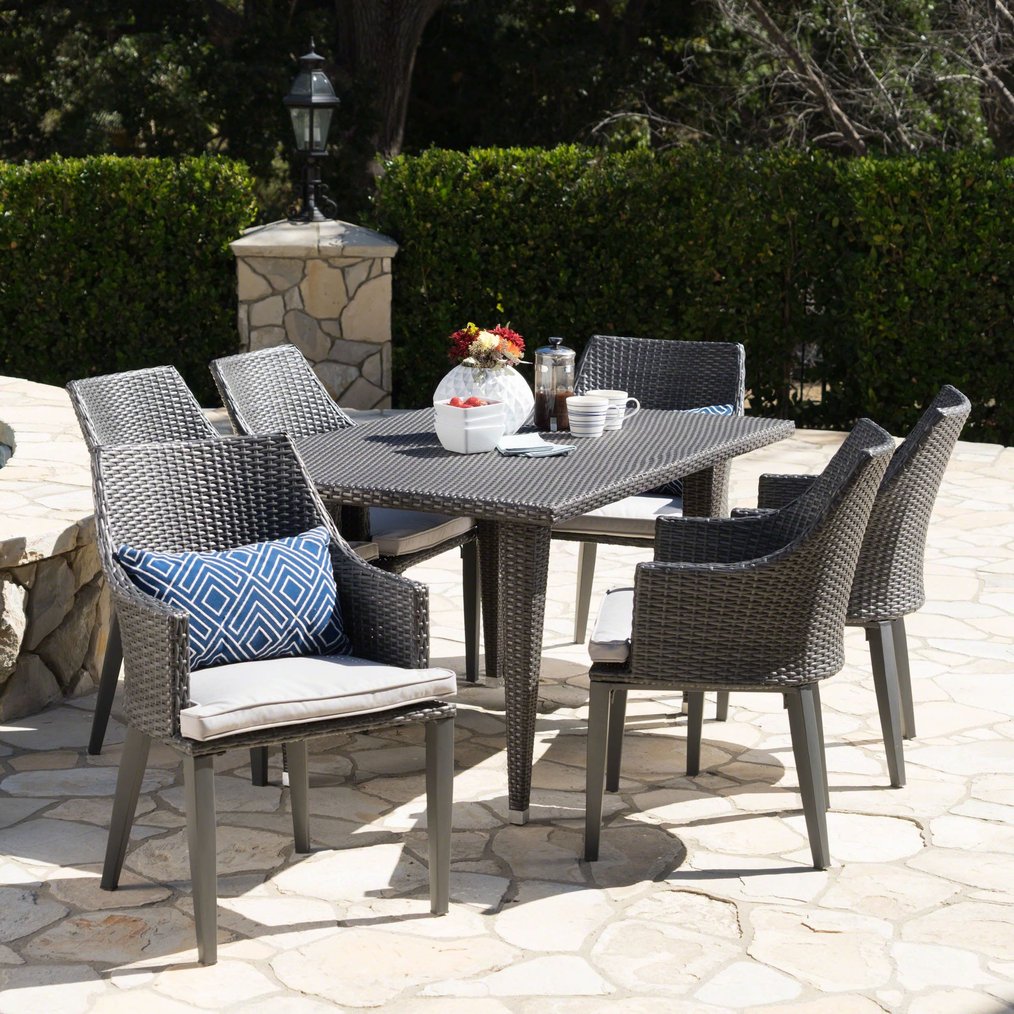 Leni Outdoor 7 Piece Wicker Rectangular Dining Set With Water Resistant Cushions