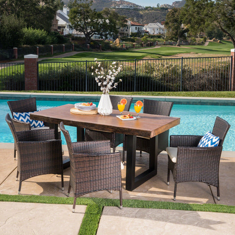 Leilani Outdoor 7 Piece Wicker Dining Set With Antique Teak Finish Concrete Table And Water Resistant Cushions