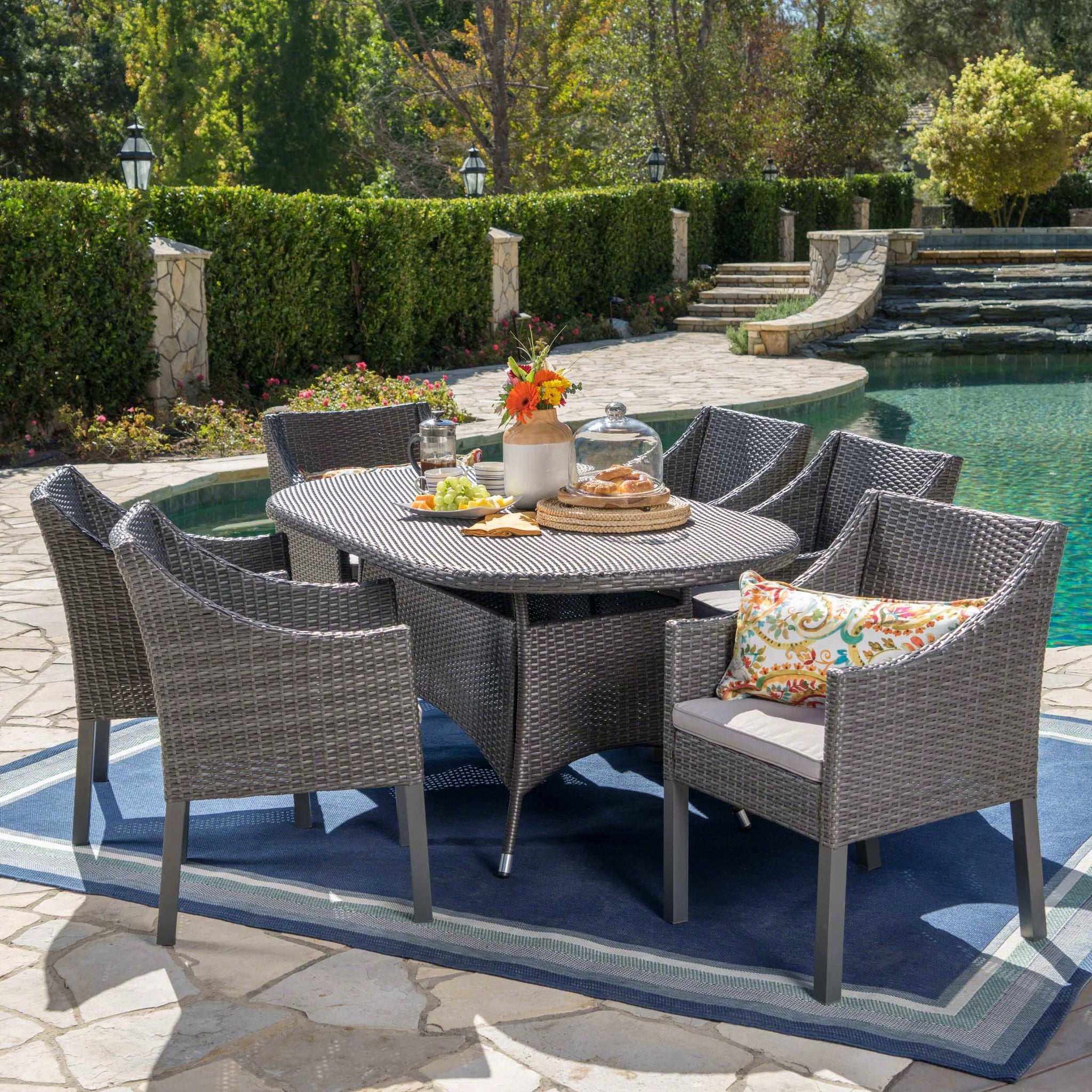 Foster Outdoor 7 Piece Wicker Oval Dining Set With Water Resistant Cushions