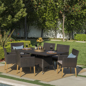 Bardow Outdoor 7 Piece Wicker Rectangular Dining Set With Wood Finished Legs And Water Resistant Cushions
