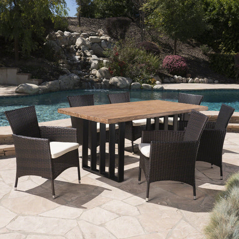 Breanna Outdoor 7 Piece Wicker Dining Set With Natural Finish Concrete Dining Table And Water Resistant Cushions
